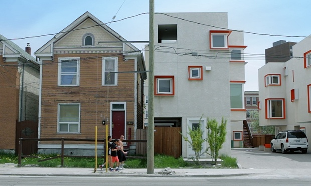 Surreal quality ... Centre Village, right, with Winnipeg's more typical wood-framed gabled houses, left. Photograph: In Context