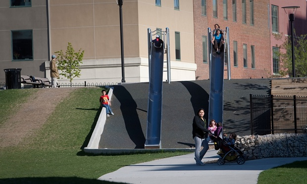 Children use the slides in Central Park, Winnipeg, one of Canada's poorest urban neighbourhoods. Photograph: Alamy